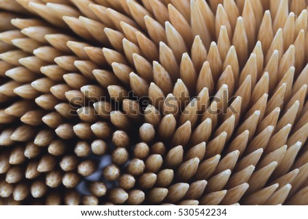Bamboo toothpicks. Close-up. Bamboo toothpicks swirl. Bamboo toothpicks texture