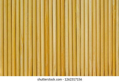 Bamboo toothpicks are placed in parallel - backgrounds, textures. Bamboo toothpicks isolated on white background. wooden toothpick isolated on white background
