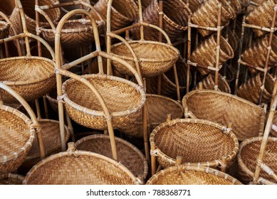 Bamboo wickerwork  baskets on the asian market place. Handmade from natural material.  Bamboo handicraft products to maintain a traditional handicraft in a countryside.