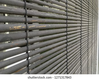 Bamboo wood curtain or blind for background and texture. Selective Focus.