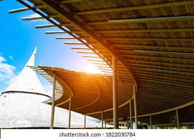 Bamboo wood roof of hat shape is vintage design to get along of agriculture farm with lighting, cloud and blue sky background.