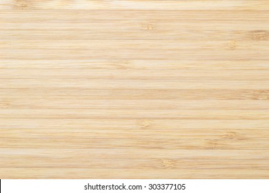 Bamboo wooden textured grainy detail backdrop in light sepia cream color