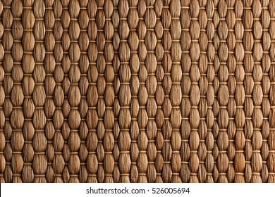 Bamboo woven brown mat handmade background. Wicker wood texture. Vertical strips.