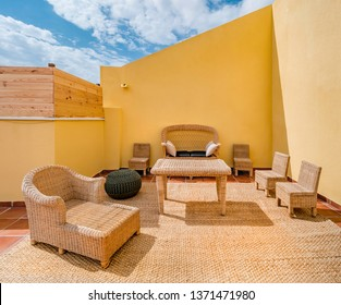 Bambu sofas in a terrace of a summer holiday property.