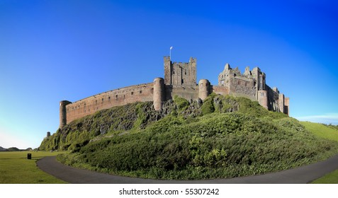 bamburgh castle in northumberland on the north east coast of england, sitting high on a rocky plateau it is one of the larget inhabited castles in the uk