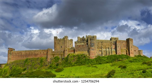 Bamburgh Castle, old castle made of stones and bricks on East Coast of Great Britain.