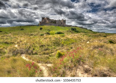 Bamburgh Castle on a hill Northumberland UK English medieval castle in colourful hdr