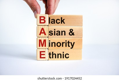 BAME symbol. Abbreviation BAME, black, asian and minority ethnic on wooden cubes. Beautiful white background. Copy space. Business and BAME, black, asian and minority ethnic concept.