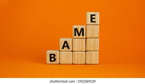 BAME symbol. Abbreviation BAME, black, asian and minority ethnic on wooden cubes. Beautiful orange background. Copy space. Business and BAME, black, asian and minority ethnic concept.