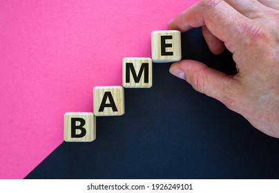 BAME symbol. Abbreviation BAME, black, asian and minority ethnic on wooden cubes. Beautiful purple and black background. Copy space. Business and BAME, black, asian and minority ethnic concept.