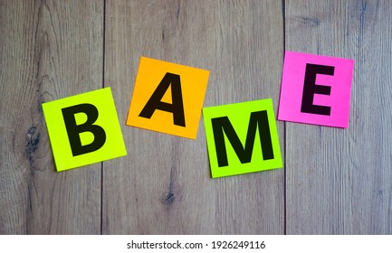 BAME symbol. Abbreviation BAME, black, asian and minority ethnic on colored papers. Beautiful wooden background. Copy space. Business and BAME, black, asian and minority ethnic concept.