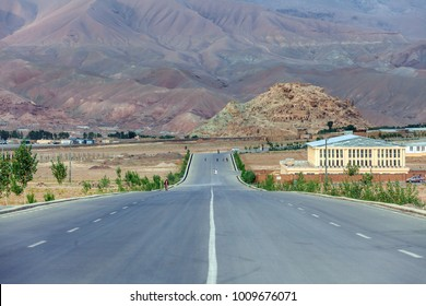 Bamiyan city in Afghanistan with a road that leads to Gholghola hills on the right.