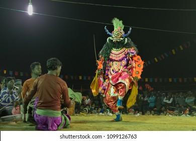 BAMNIA, PURULIA, WEST BENGAL , INDIA - DECEMBER 23RD 2015 : Dancer performing at Chhau Dance festival, resurrecting a demon. It is a Indian tribal martial dance, based on Hindu myth.