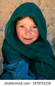 Bamyan (Bamiyan) / Central Afghanistan - 19 Aug 2005: This poor girl lives in the caves in Bamyan (Bamiyan), Afghanistan. A cave dweller in the cliffs near to the Bamyan (Bamiyan) Buddhas, Afghanistan