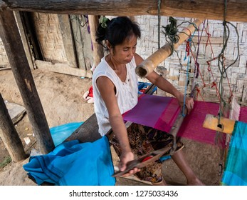 ban boe bak baw, laos - november 19, 2018: 600 year old mountain village on the banks of the mekong. minorities of the shan live here. woman at the loom. produces traditional crafts on simple looms.