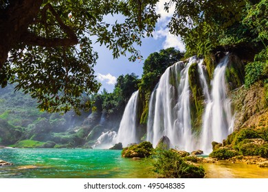 Ban Gioc waterfall in Cao Bang, Viet Nam - The waterfalls are located in an area of mature karst formations were the original limestone bedrock layers are being eroded