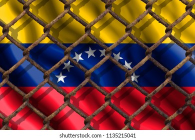 The ban on freedom of speech. The concept of the country's immigration policy regarding migrants, illegal immigrants and refugees. Steel grid on the background of the flag of Venezuela