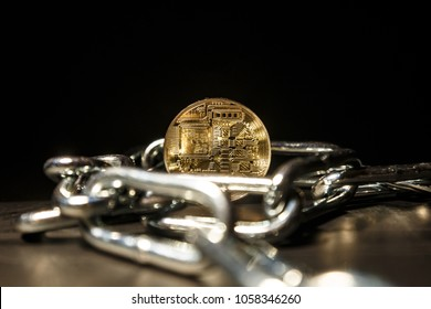 Ban on illegal investing in Initial Coin Offering. A coin of electronic currency in chains as a symbol of illegal ICO.