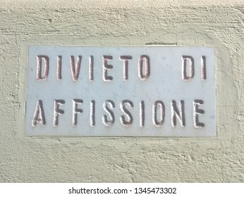 Ban on posting (Divieto di affissione), marble plaque on the wall of a building in Mantua.