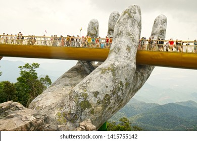 Bana Hill Danang Vietnam - 7 May 2019 : The Golden Bridge with two giant hands in the Ba Na Hill Danang, Vietnam is favorite landmark of danang - Raining season