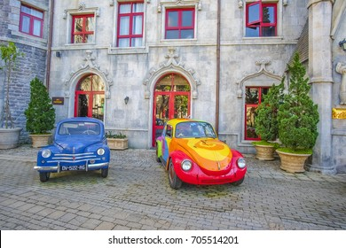 Bana Hills, Da Nang, Vietnam.JUNE 6 ,2017: Landscape of Castles at  Bana Hills in Danang and colorful vintage car