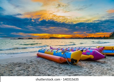 The banana boat with beautiful sky in the evening at Nang rum beach for background use ,Rayong ,Thailand