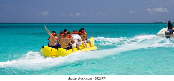 A Banana Boat Full of Tourists Speeding Away