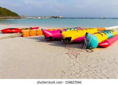banana boat lays on a beach