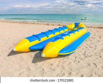 Banana boat lays on the beach