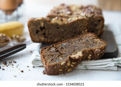 banana bread with walnuts on a white kitchen table. proper nutrition