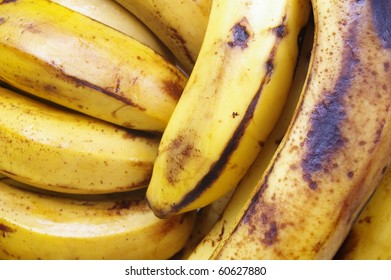 banana bunch on the turn in a market stall