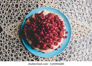 Banana cake with berries