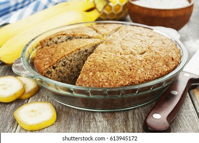 Banana cake and fresh bananas on the table