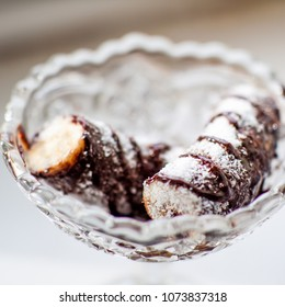 Banana in chocolate with copra
