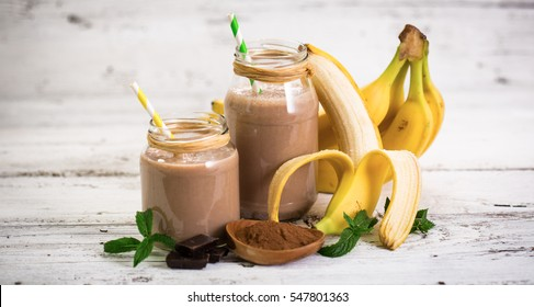 Banana and chocolate smoothie in the glass jar