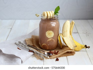 Banana chocolate smoothie with nuts and mint leaf