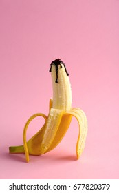 Banana covered with chocolate sauce on color background. Sex concept