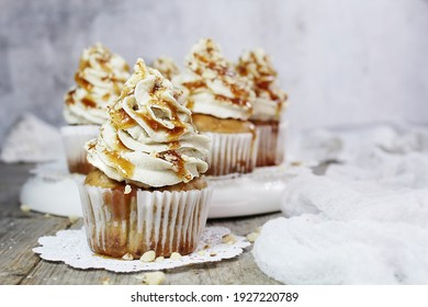 Banana Cupcakes with Buttercream Icing, Drizzled with Caramel and topped with Almonds - Vegan