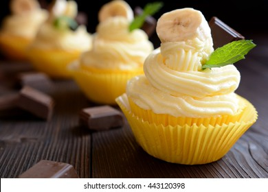 Banana cupcakes on black background