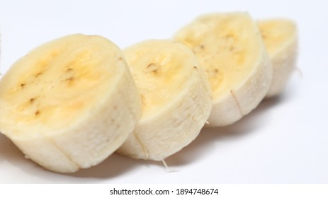 Banana cut on white background, great for design backgrounds