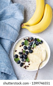 Banana dairy free nice cream or smoothie bowl topped with blueberry overhead