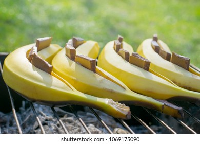 Banana dessert with chocolate. Preparation on the grill. Summer menu