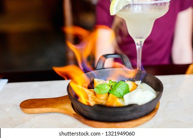 Banana flambe with rum and aged honey served over pancakes and vanilla ice cream