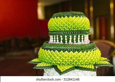 banana leaf decorated on tray with pedestal