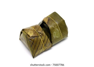 Banana leaf wrapped rice on isolate background