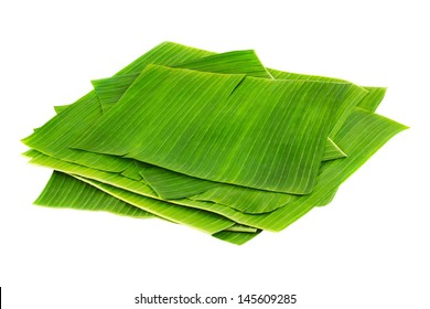 Banana leaves for wrapping or serving food as ecological dishware, isolated on white