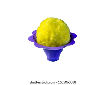 Banana or Lemon Hawaiian shave ice, shaved ice or snow cone in a purple flower shaped serving container on a white background.