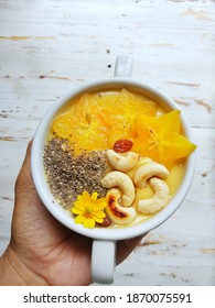 banana and mango smoothies with star fruit, chiaseed and cashew nut