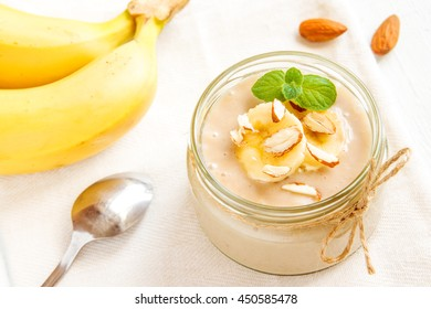 Banana mousse with almond and mint for healthy vegetarian dessert