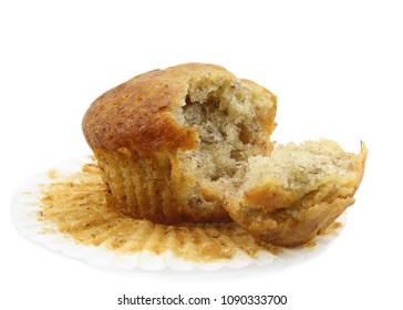 Banana muffin cupcake isolated on white background.